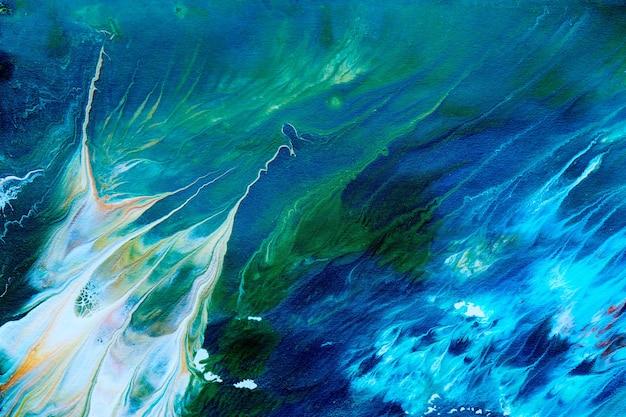 Abstracte vloeibare blauwgroene patroonachtergrond. kosmische zeegolven, verfvlekken, creatieve vloeibare kunst. kleuren van de planeet aarde