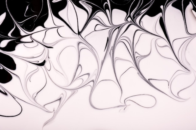 Abstracte vloeibare kunst zwart-witte kleuren als achtergrond.