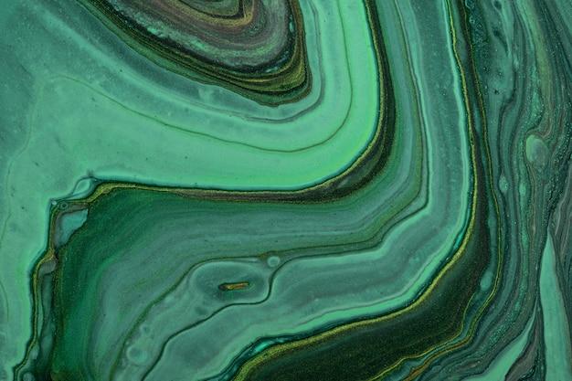 Abstracte vloeiende kunst achtergrond donkergroene en zwarte glitterkleuren. vloeibaar marmer. acryl schilderij op canvas met smaragd kleurverloop
