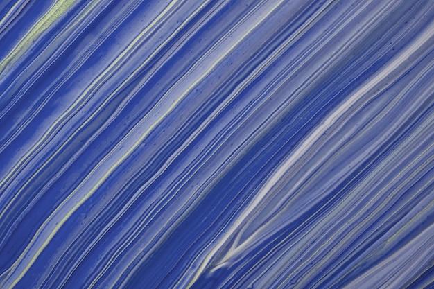 Abstracte vloeiende kunst achtergrond marineblauwe en gouden glitterkleuren. vloeibaar marmer. acryl schilderij op canvas met saffier verloop