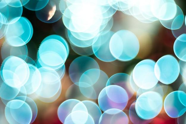 Abstracte wazig bokeh blauwe pasteltint kleurrijk. lens flare licht afbeelding. vintage toon kleurenfilter. blauwe tosca bubble achtergrond