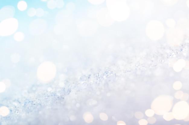 Abstracte witte achtergrond met gouden lichten, macroschot