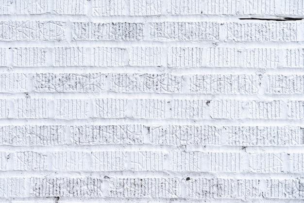 Abstracte witte bakstenen muurachtergrond