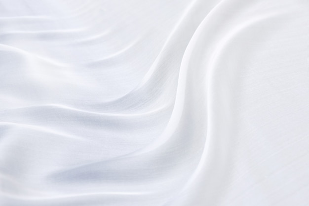 Abstracte witte beddengoed lakens of deken achtergrond en textuur
