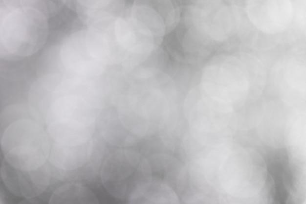 Abstracte witte en grijze bokehachtergrond.