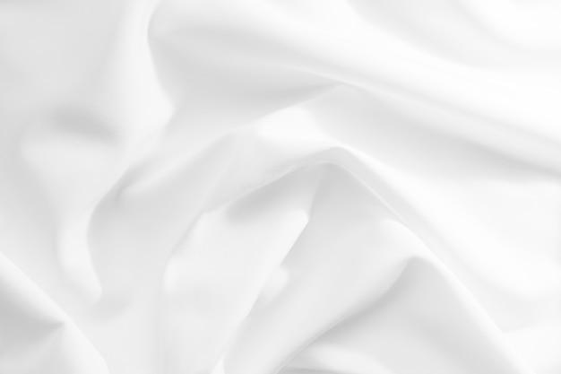 Abstracte witte stof textuur achtergrond. doek zachte golf. vouwen van satijn, zijde en katoen.
