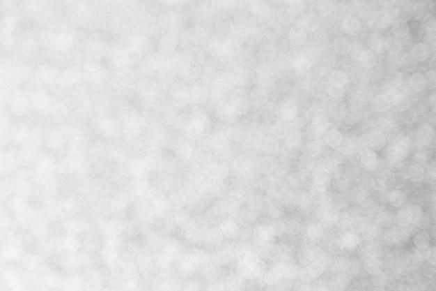 Abstracte zilveren bokeh voor kerstmisachtergrond, vieringsconcept.