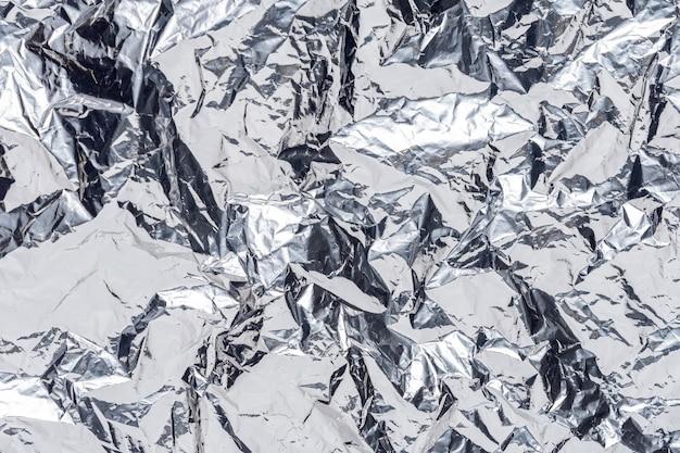 Abstracte zilveren verfrommelde folieachtergrond.