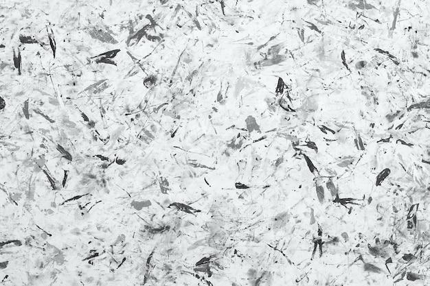 Abstracte zwart-wit verf achtergrondstructuur. penseelstreken van verf. moderne kunst. eigentijdse kunst. willekeurige waterverfdruppels.