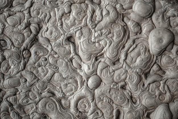 Abstracte zwart-wit zeldzame stenen textuur achtergrond.