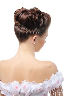 Achter mening van modern huwelijkskapsel - elegantie jonge bruid