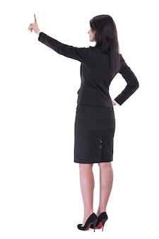 Achter view.business vrouw wijzend naar virtuele punt. geïsoleerd op witte achtergrond