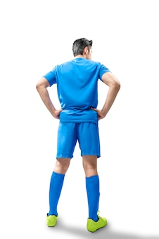 Achteraanzicht van voetballer man die