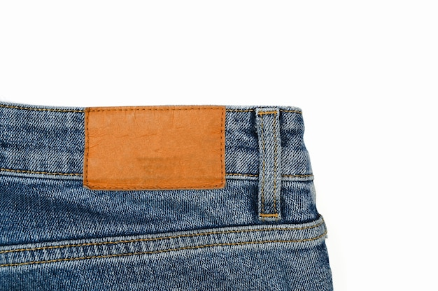 Achteretiket op jeans, close-up.