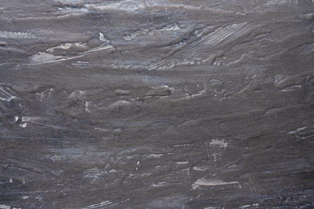 Achtergrond armoedige zwart-grijze muur met strepen, getextureerde, driedimensionale textuur