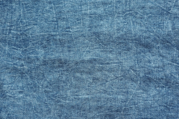 Achtergrond en textuur van blauwe denim met slijtage.