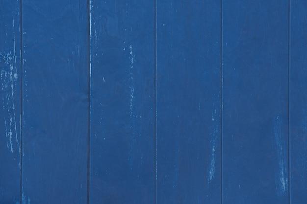 Achtergrond en textuur van oude planken geschilderd in trendy klassiek blauw