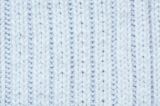 Achtergrond en textuur witte gebreide wollen stof.