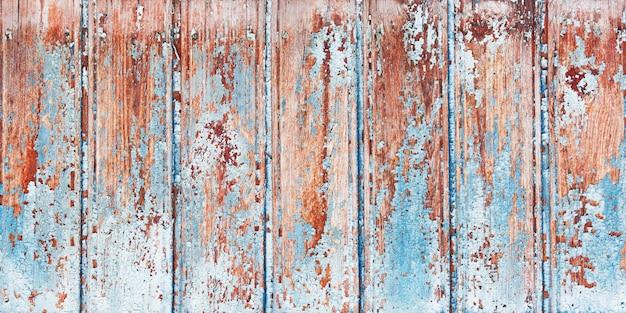 Achtergrond houten bord met gebarsten verf.