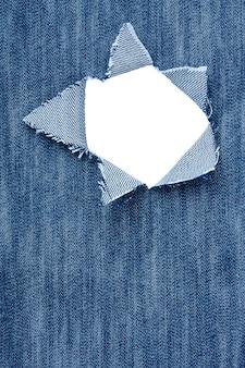 Achtergrond - jeans met gaten en plaats voor tekst