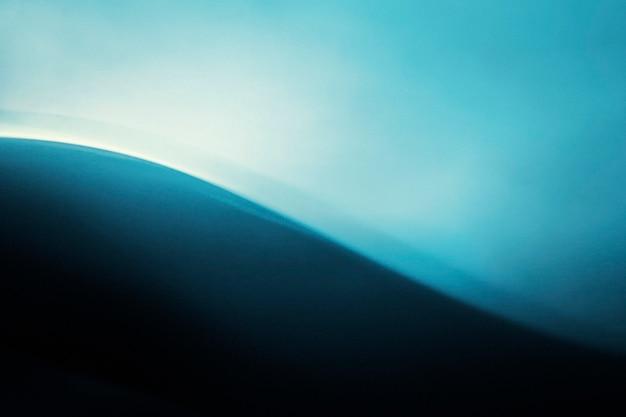 Achtergrond met kleurovergang met blauw lichteffect