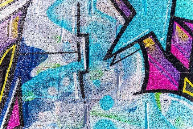 Achtergrond met muurtextuur met kleurrijke lijnen wordt geschilderd die.
