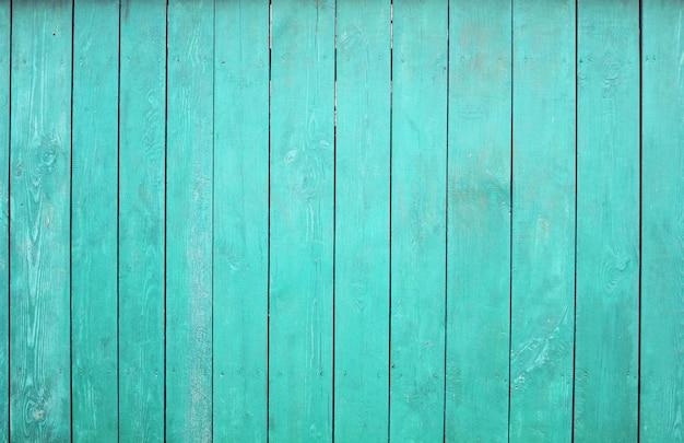 Achtergrond met turkoois houten hek