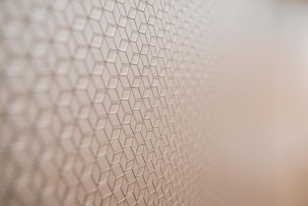 Achtergrond met zachte geometrische patroon gericht close-up en kopieer ruimte