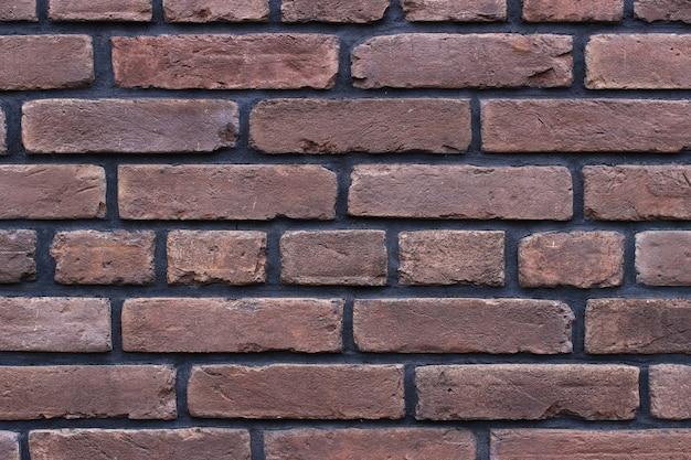 Achtergrond of textuur van een bruine bakstenen muur