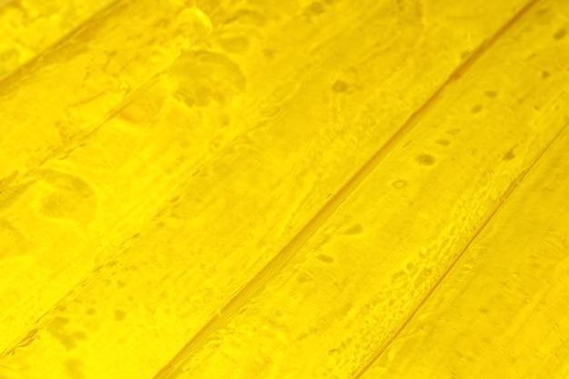 Achtergrond - ongesneden gelatinelinten voor het maken van marmeladeplakken in een banketbakkerij