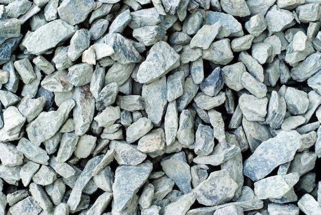 Achtergrond, textuur - grijze kalksteen verpletterde steen close-up