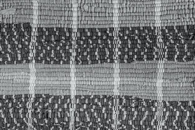 Achtergrond, textuur van gekleurd handgemaakt tapijt. stoffen vloerkleed met kleine stukjes