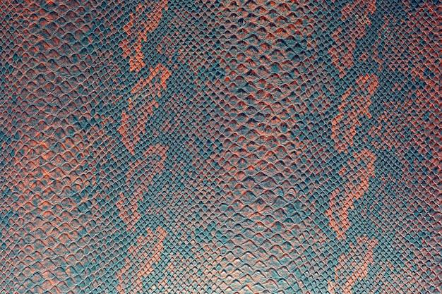 Achtergrond textuur van slangenhuid helder rood