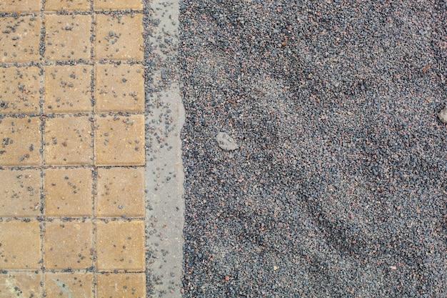 Achtergrond uit de textuur van decoratieve tegels met klein grind