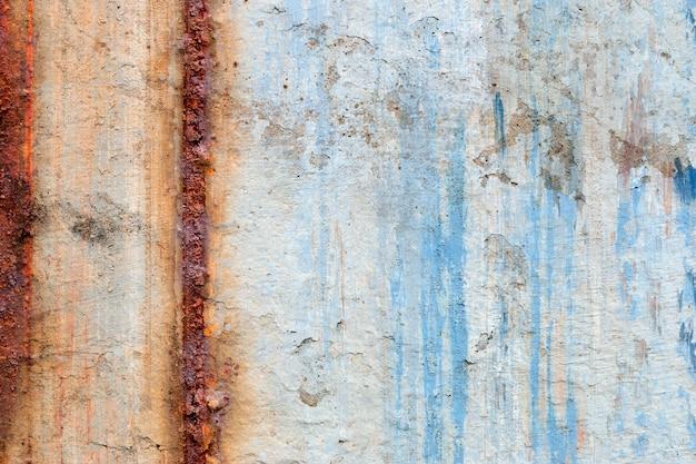 Achtergrond van afbladderende verf en roestig oud metaal