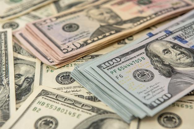 Achtergrond van amerikaanse dollarbiljetten. top uitzichtpunt. financieel concept