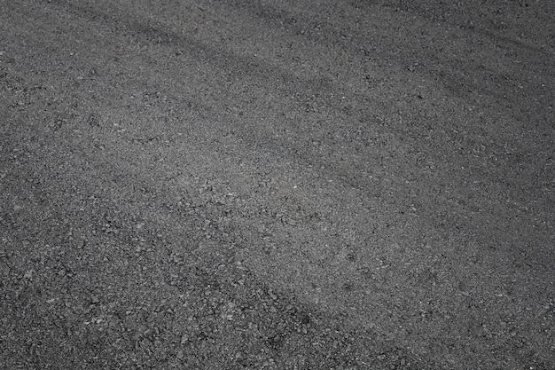 Achtergrond van asfaltweg vanaf het bovenaanzicht