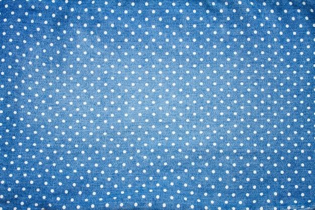 Achtergrond van blauwe spijkerbroek met polka dot patroon