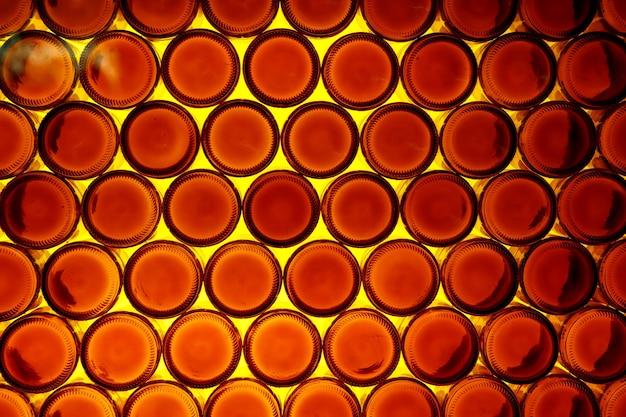 Achtergrond van bodems van oranje flessen.