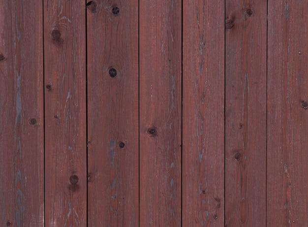Achtergrond van bruin houten planken, houtstructuur met knopen, oud, vintage