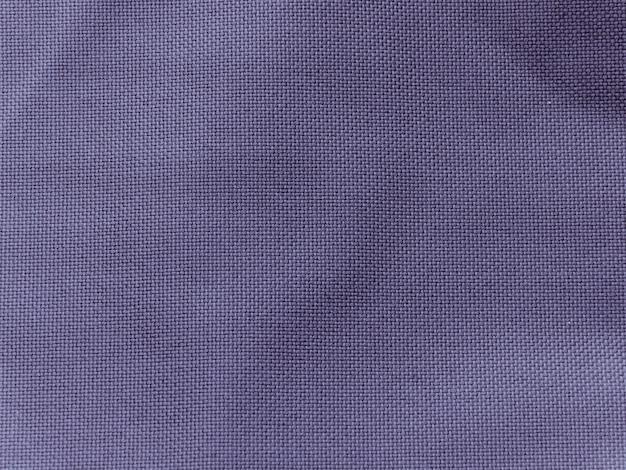 Achtergrond van de blauwe textuur van de linnenstof