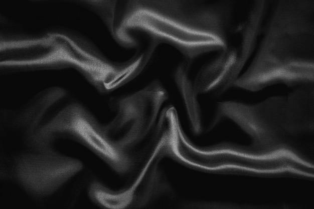 Achtergrond van de de doektextuur van het rimpel de zwarte satijn