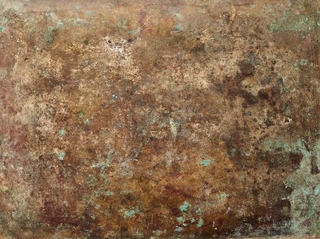 Achtergrond van de de oppervlaktetextuur van het grungemetaal de bruine lege exemplaar ruimte