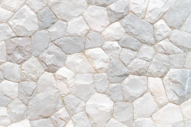 Achtergrond van de de steenmuur van de textuurrots de grijze