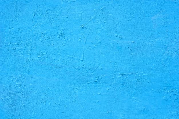Achtergrond van een blauwe geschilderde cementmuur, ruwe gietvorm van cement en betonnen muurtextuur