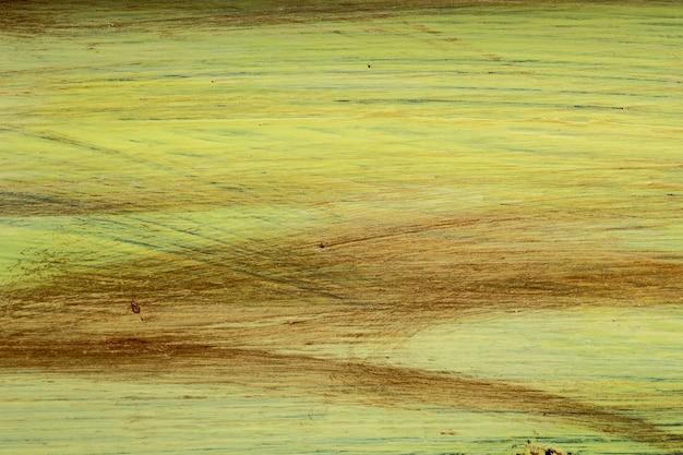 Achtergrond van een gele en bruine penseelstreekverf.
