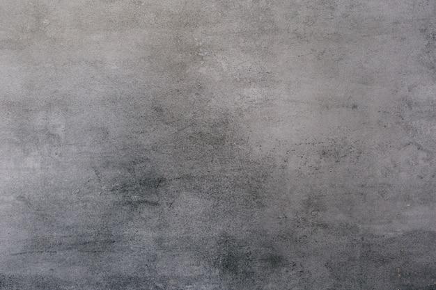 Achtergrond van een grijze gipspleister gecoat en geschilderd buitenkant, ruwe cast van cement en betonnen muur textuur