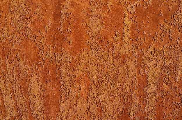 Achtergrond van een roestige oude ijzeren metalen plaat, oranje en bruine kleuren