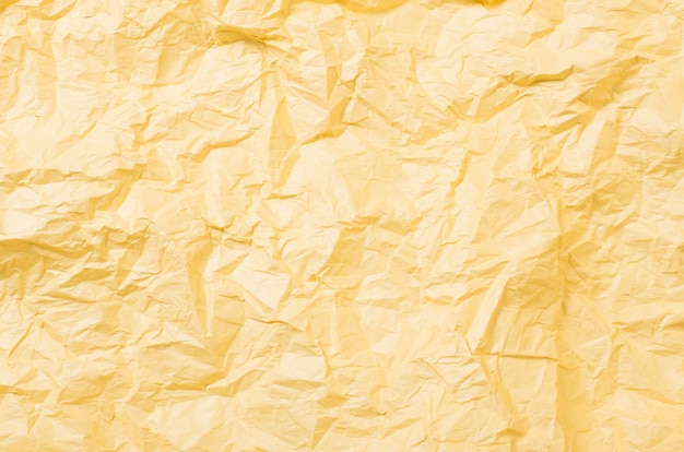 Achtergrond van geel verfrommeld papier