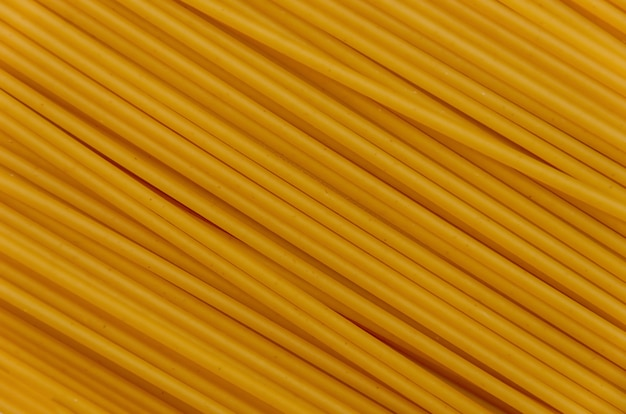 Achtergrond van gele spaghettibuizen